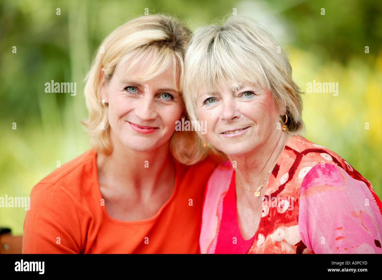 grown up daughter with mother in garden Stock Photo