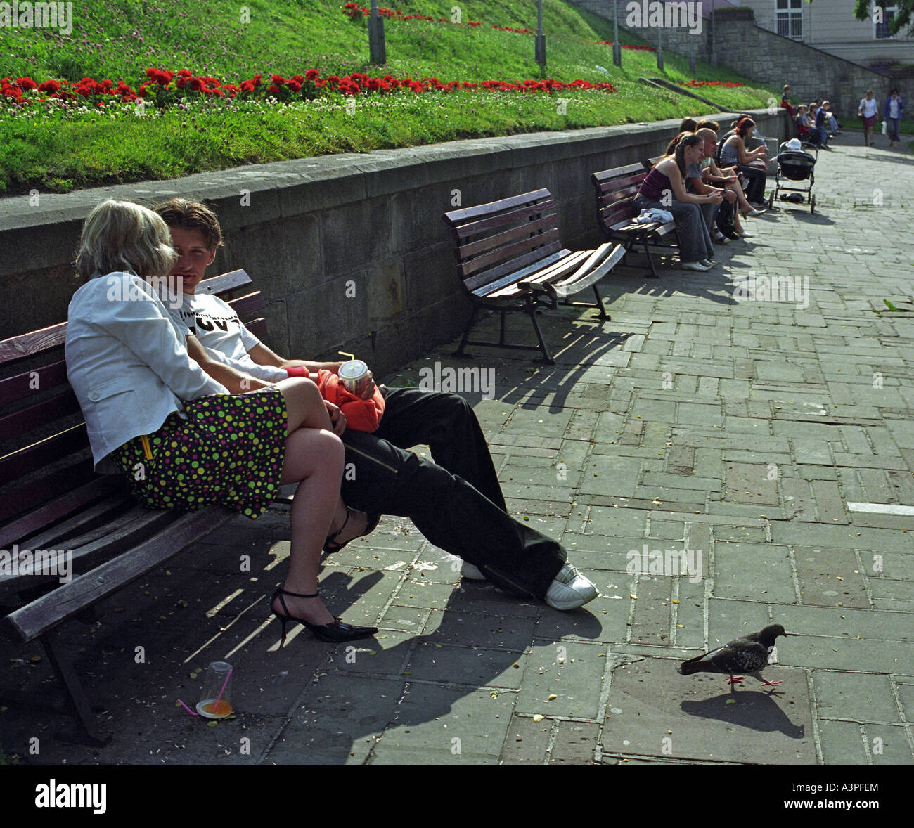People sitting on benches in Przemysl, Poland Stock Photo