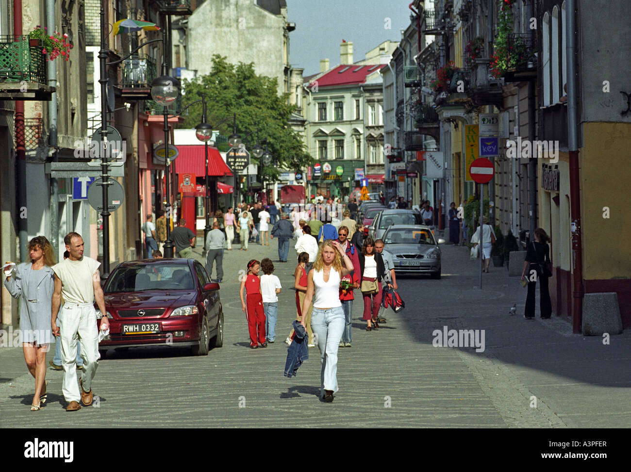 People walking in the old town of Przemysl, Poland Stock Photo