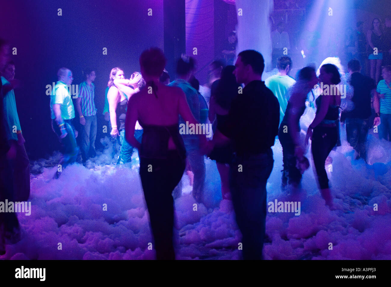 Group of people dancing in nightclub. Foam Party. Exit Club, Greenpoint, Brooklyn, New York. USA - Stock Image