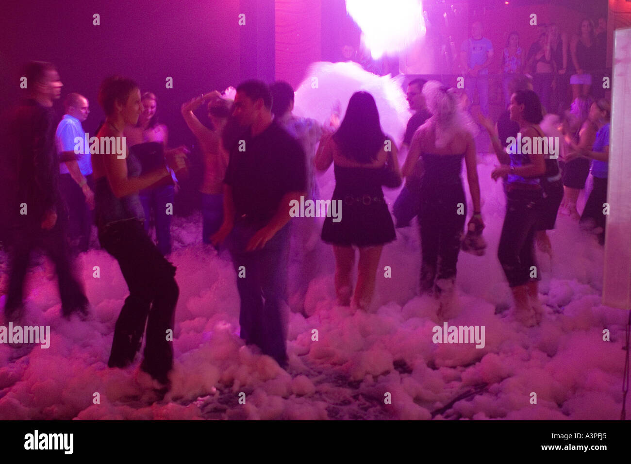 Group of people dancing in nightclub. Foam Party. Exit Club, Greenpoint, Brooklyn, New York. - Stock Image