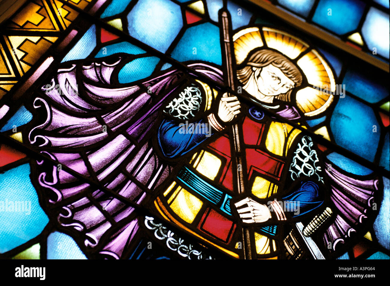Stained glass window detail St George slaying a dragon - Stock Image