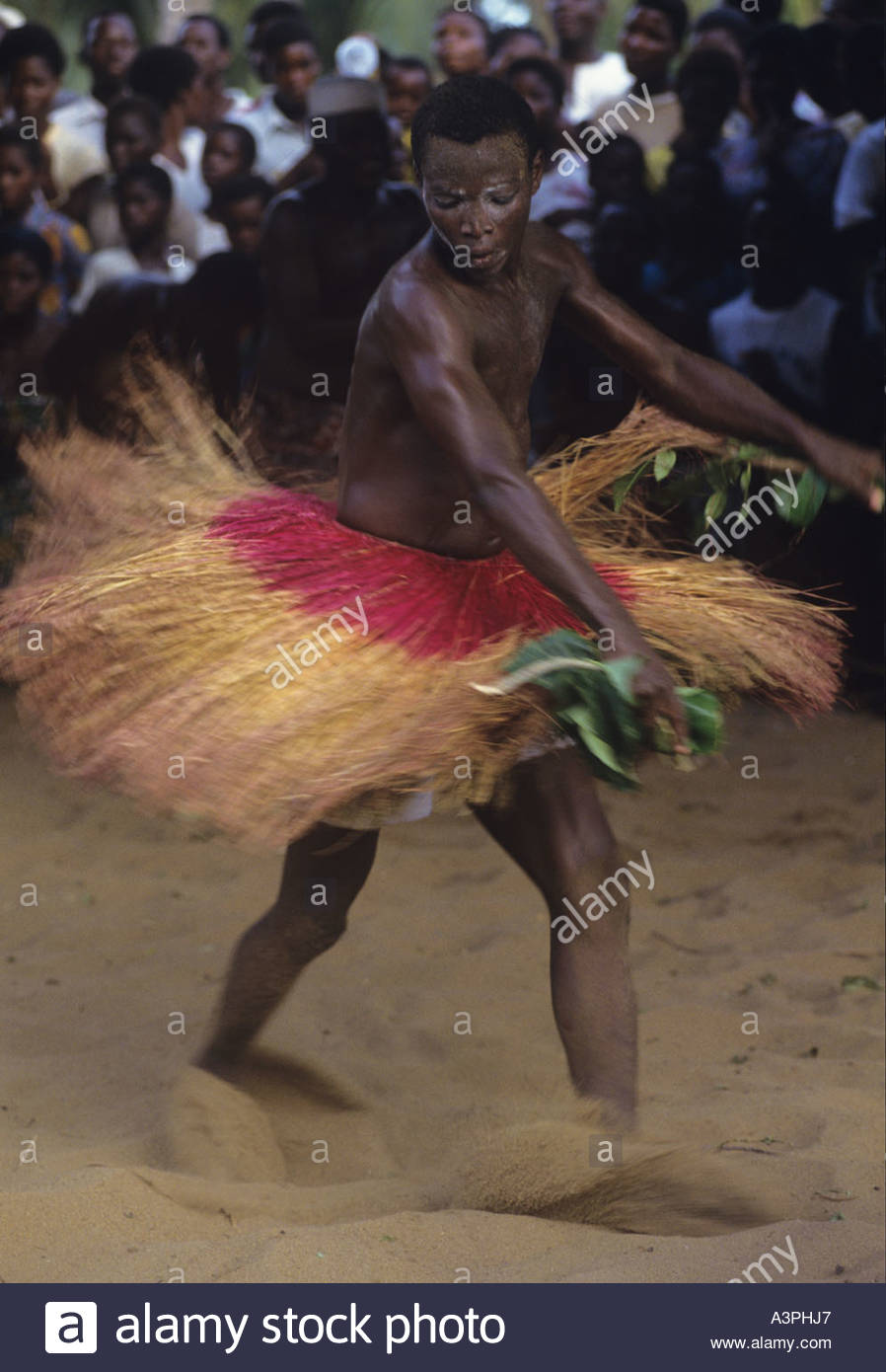 Voodoo dancer covered in Palm oil and sand spins his way into a trance at Kokuzahn festival - Stock Image