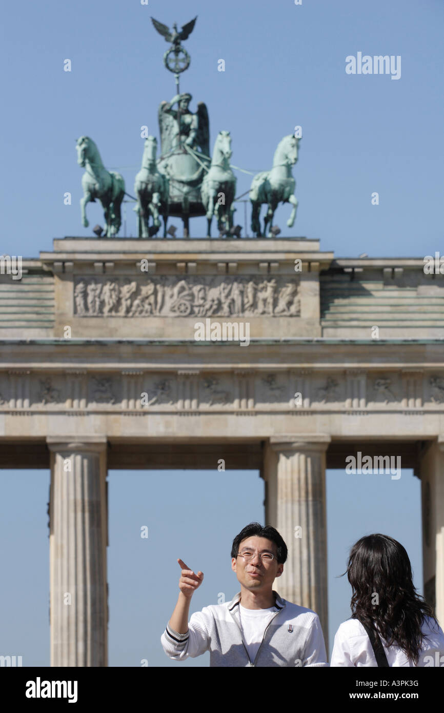 Asian tourists in front of the Brandenburg Gate in Berlin, Germany Stock Photo