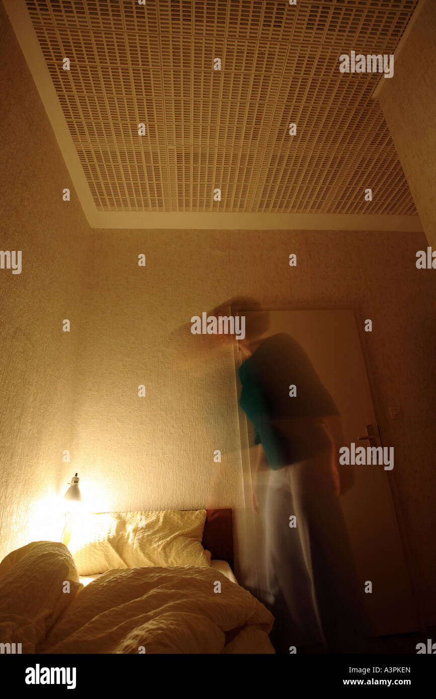 Woman going to bed - Stock Image