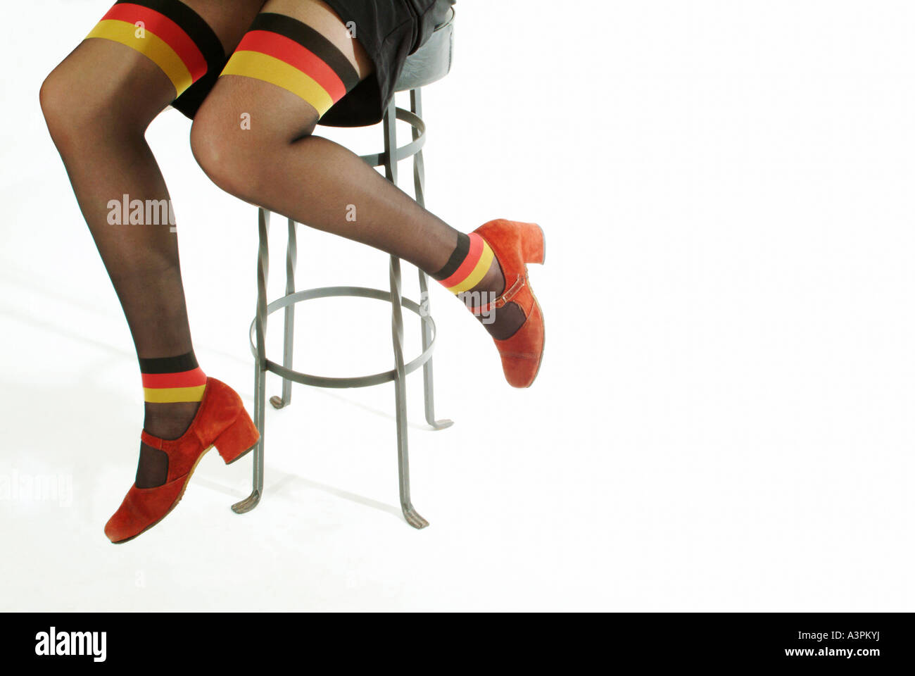 Woman wearing pantyhose with Germany national colours - Stock Image