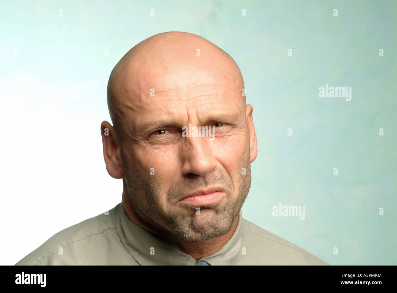 Man with a reluctant look on his face - Stock Image