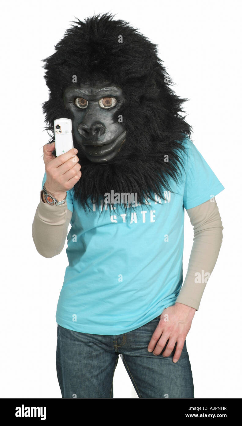 Man wearing the head of a gorilla costume and looking at his mobile phone  sc 1 st  Alamy & Man wearing the head of a gorilla costume and looking at his mobile ...