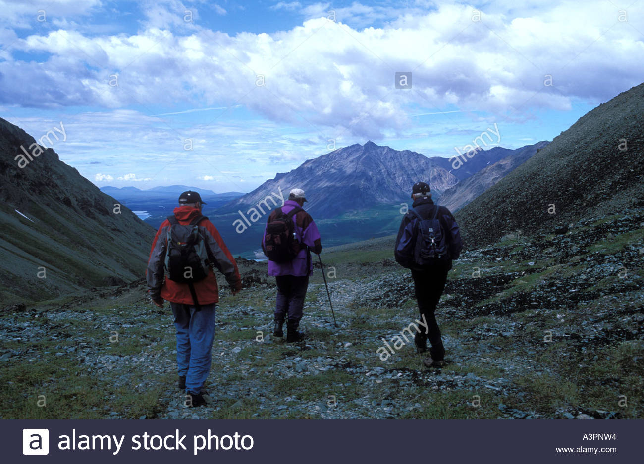 Hikers at Low Pass above Twin Lakes Chigmit Mountains Lake Clark National Park Alaska - Stock Image