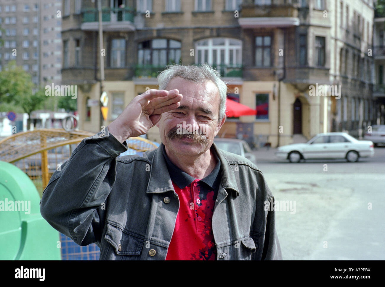 Man making a greeting gesture, Poznan, Poland. - Stock Image