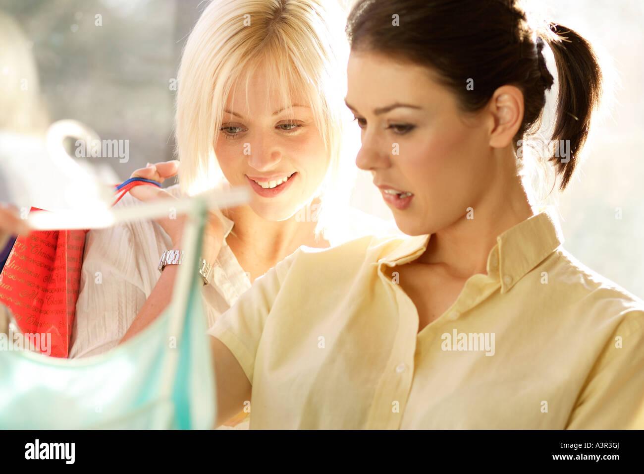 Two girls shopping - Stock Image