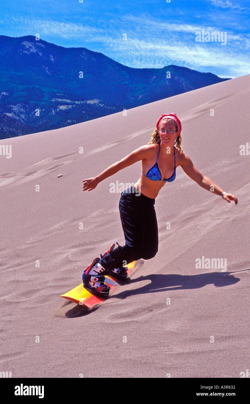 woman snowboarding on sand dunes Stock Photo: 2012721 - Alamy