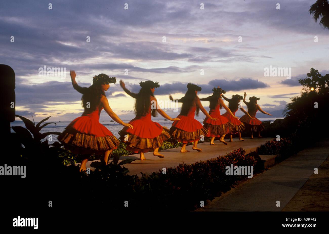 Traditional hula dancers preforming at a luau in Lahaina Maui Hawaii - Stock Image