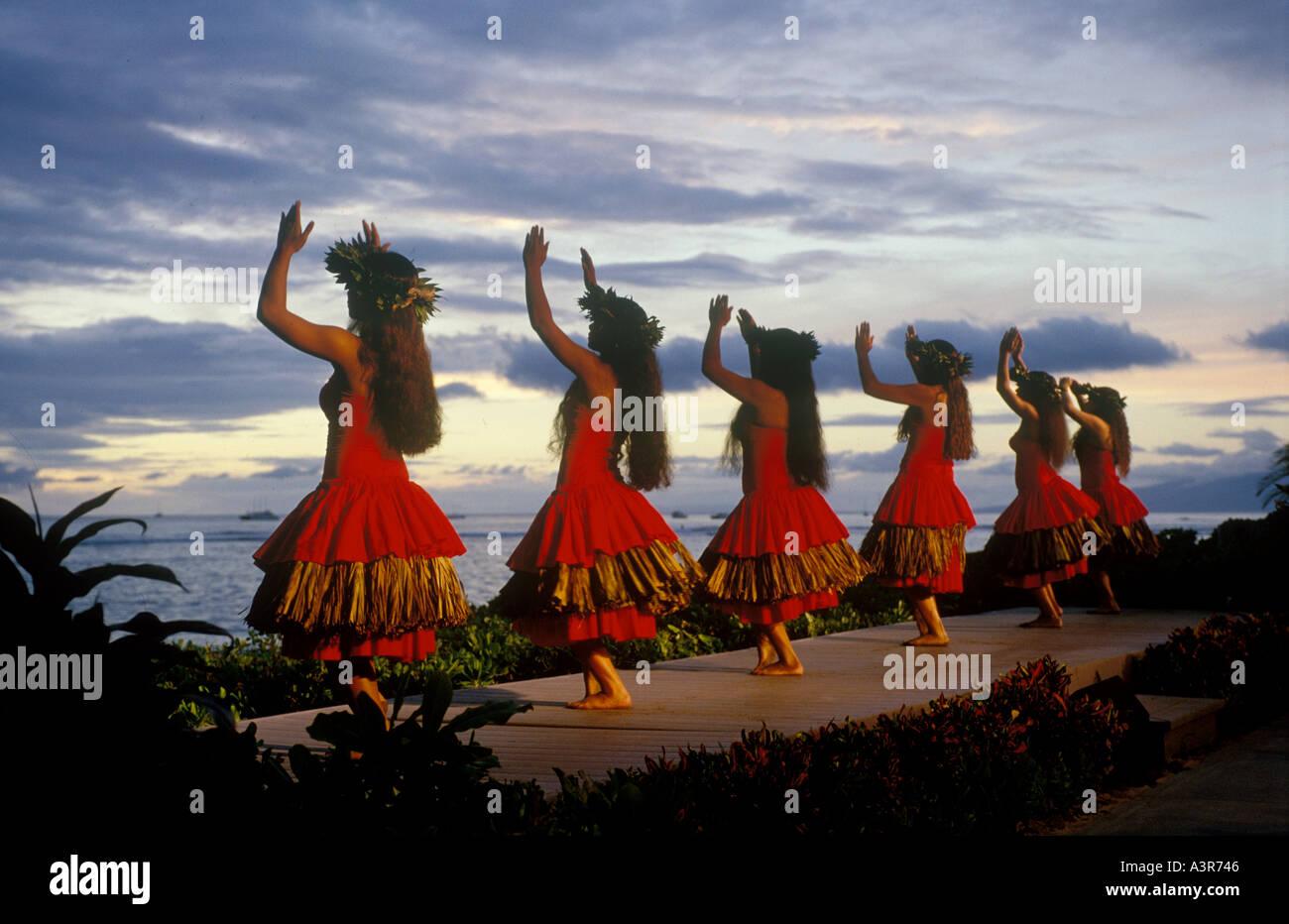 tradition hawaiian dancers preforming a hula at a luau in Lahaina Maui Hawaii - Stock Image