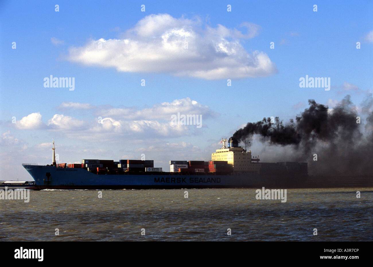 Carbon dioxide emissions from the engines of a container ship leaving the port of Felixstowe, Suffolk, UK. - Stock Image