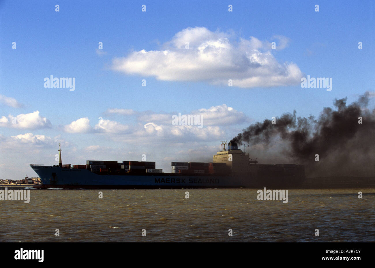 A container ship which burns a cheaper sulphur-rich fuel called 'bunker oil', port of Felixstowe, Suffolk, - Stock Image