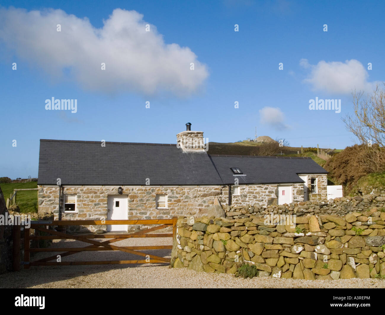 Traditional single storey traditional stone cottage with slate roof ...
