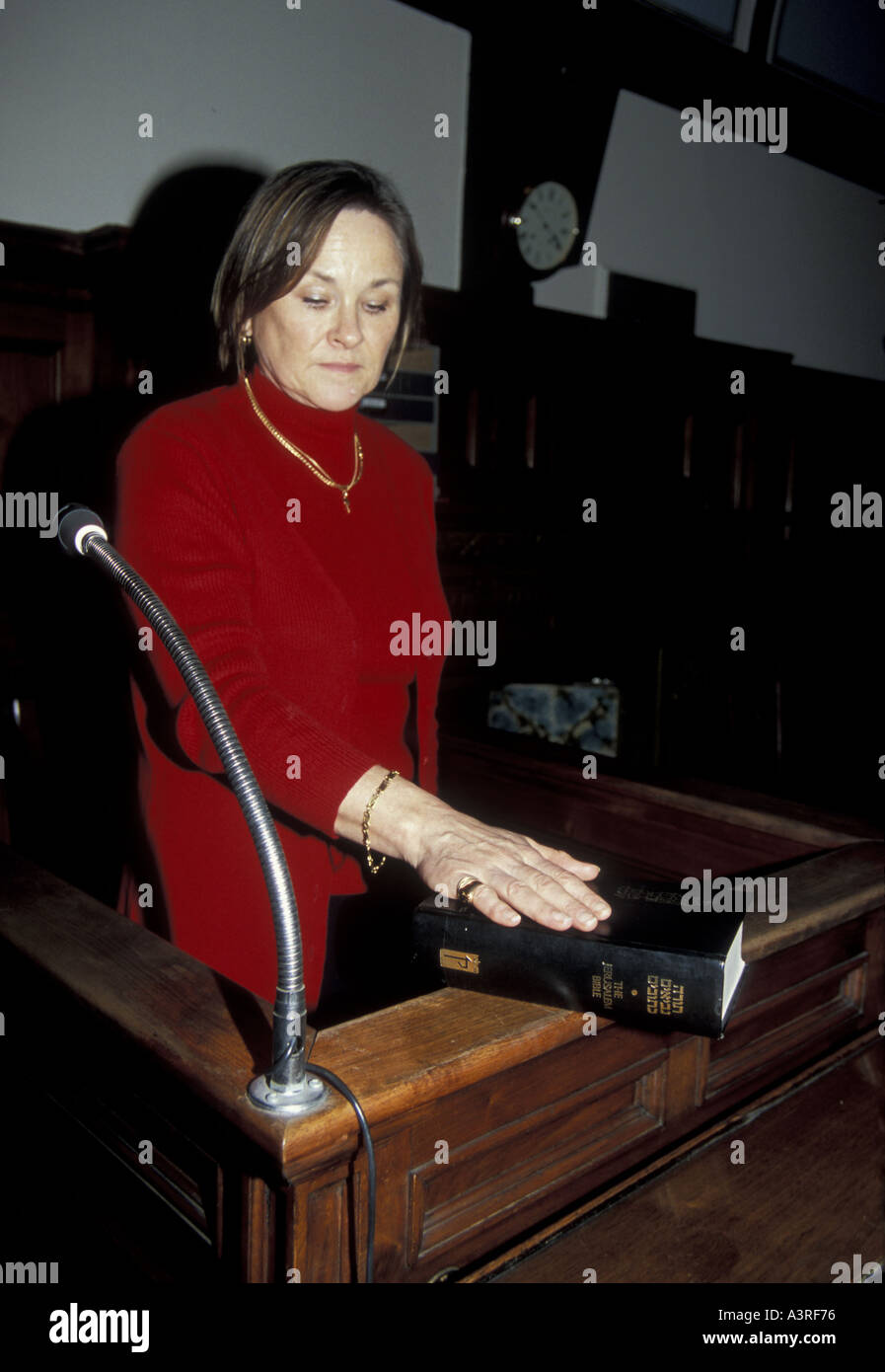 JUDAISM a woman witness swears an oath on the torah in a  Coroner Court London - Stock Image