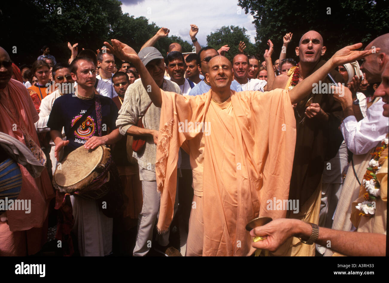 Hare Krishna Radha Krishna Devotees dance down Park Lane WI HOMER SYKES Stock Photo