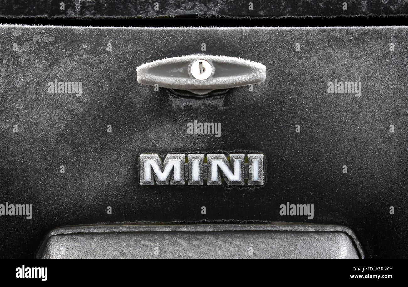 A CLASSIC ROVER MINI CAR SHOWING FROSTY MINI LOGO AND BOOT HANDLE.UK - Stock Image