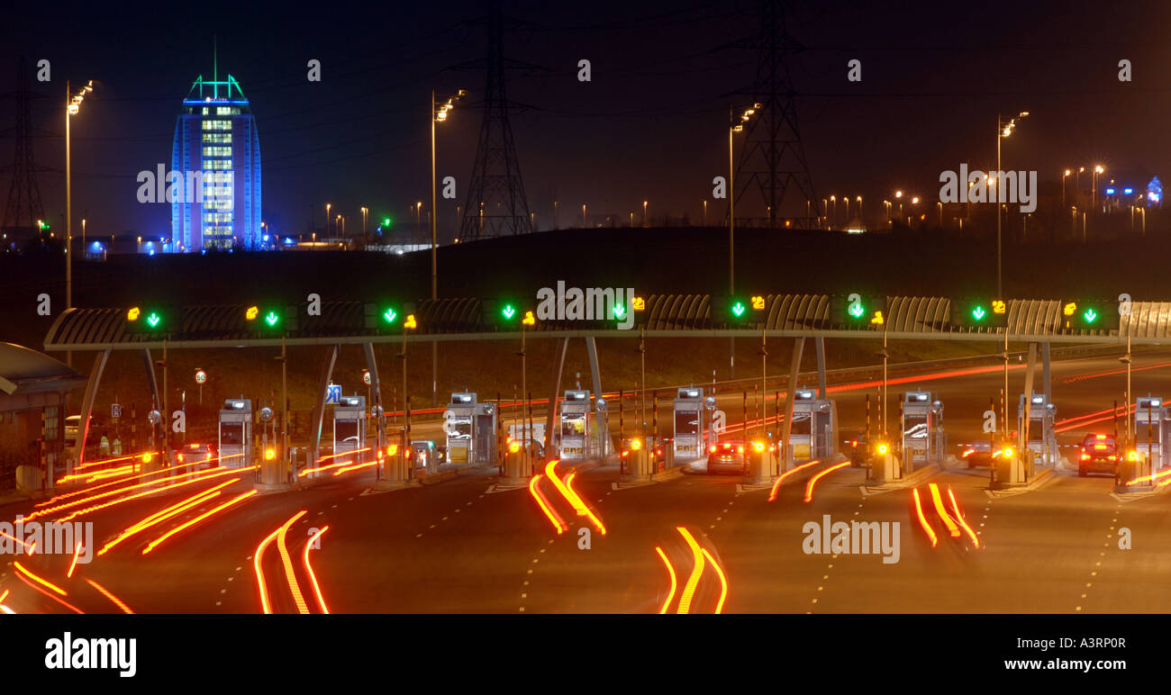 M6 TOLL ROAD BOOTHS NEAR CANNOCK,STAFFORDSHIRE WITH RAMADA HOTEL IN BACKGROUND. - Stock Image