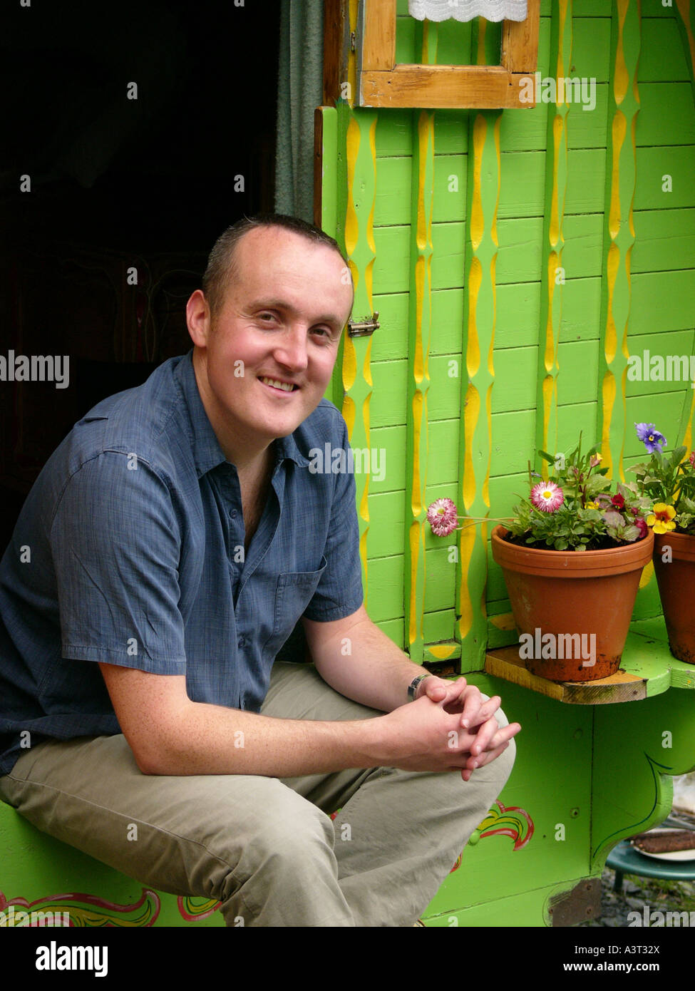 Romany Caravan holiday accommodation in rural west wales - with owner Greg Stevenson of Under the Thatch holiday - Stock Image