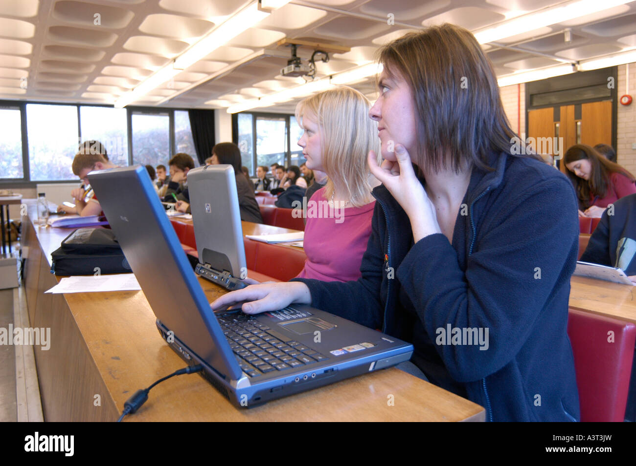 women students taking notes on laptop computers during a lecture in Law department Aberystwyth university Wales - Stock Image