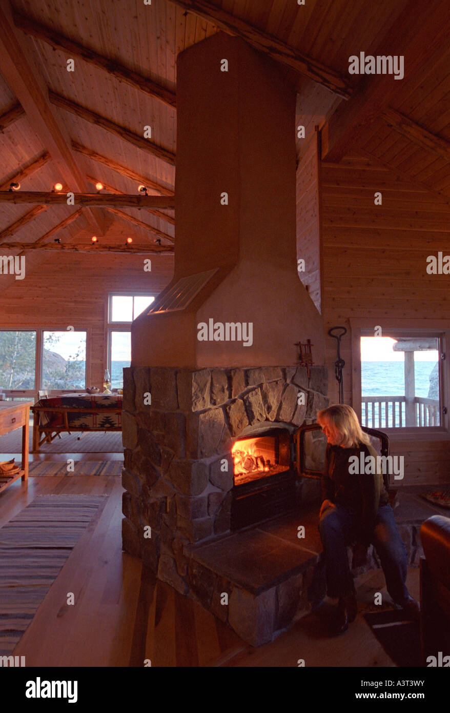 phyllis berg pigorsch fires up the custom fireplace in her lake rh alamy com custom fireplace the forest