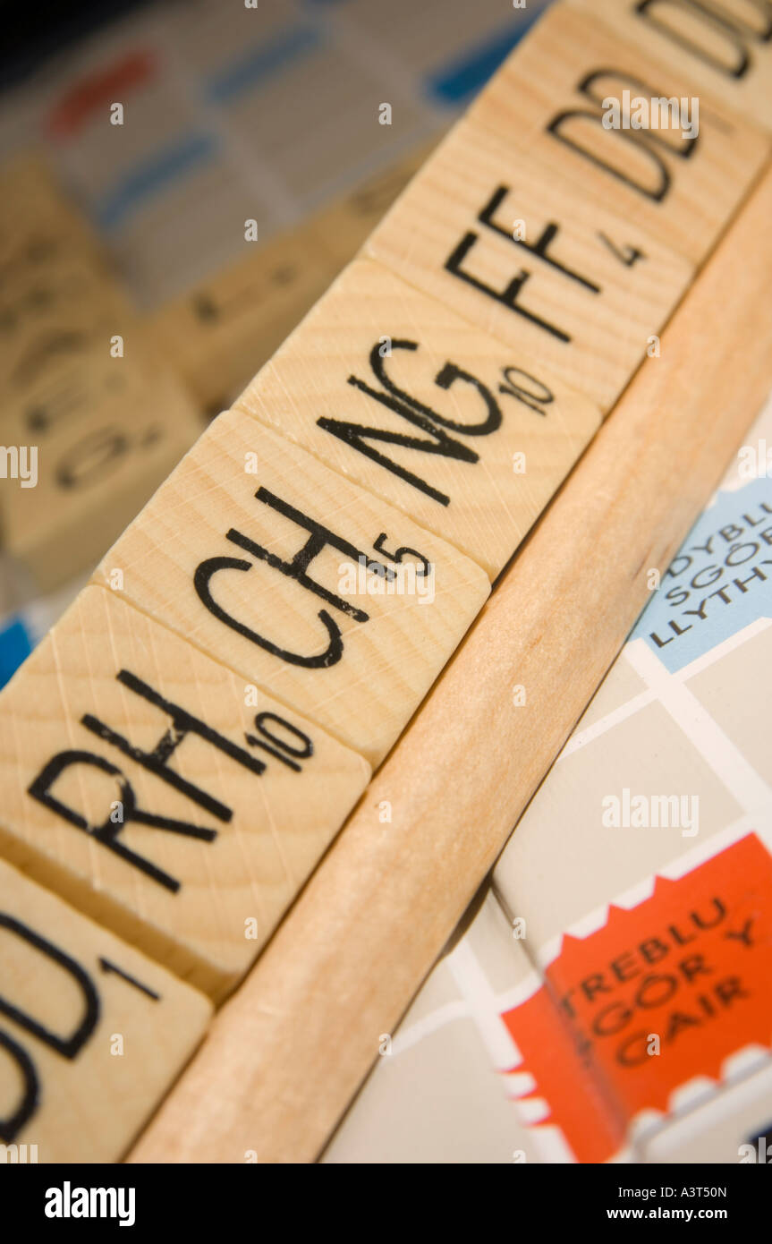 WELSH language version of scrabble word board game showing double letter tiles digraphs - Stock Image