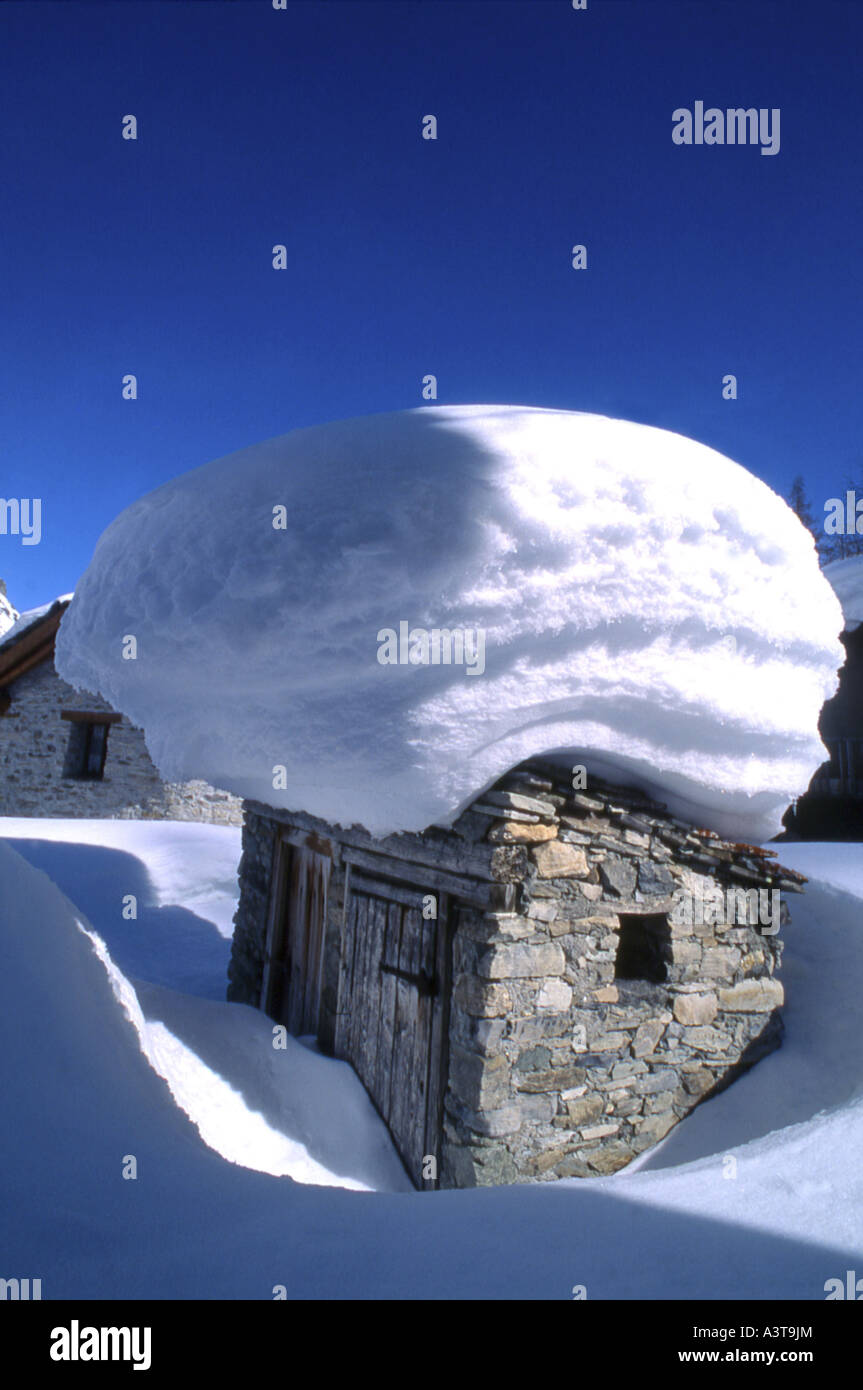 cottage after snow fall, France, Savoie, Val d Isre - Stock Image