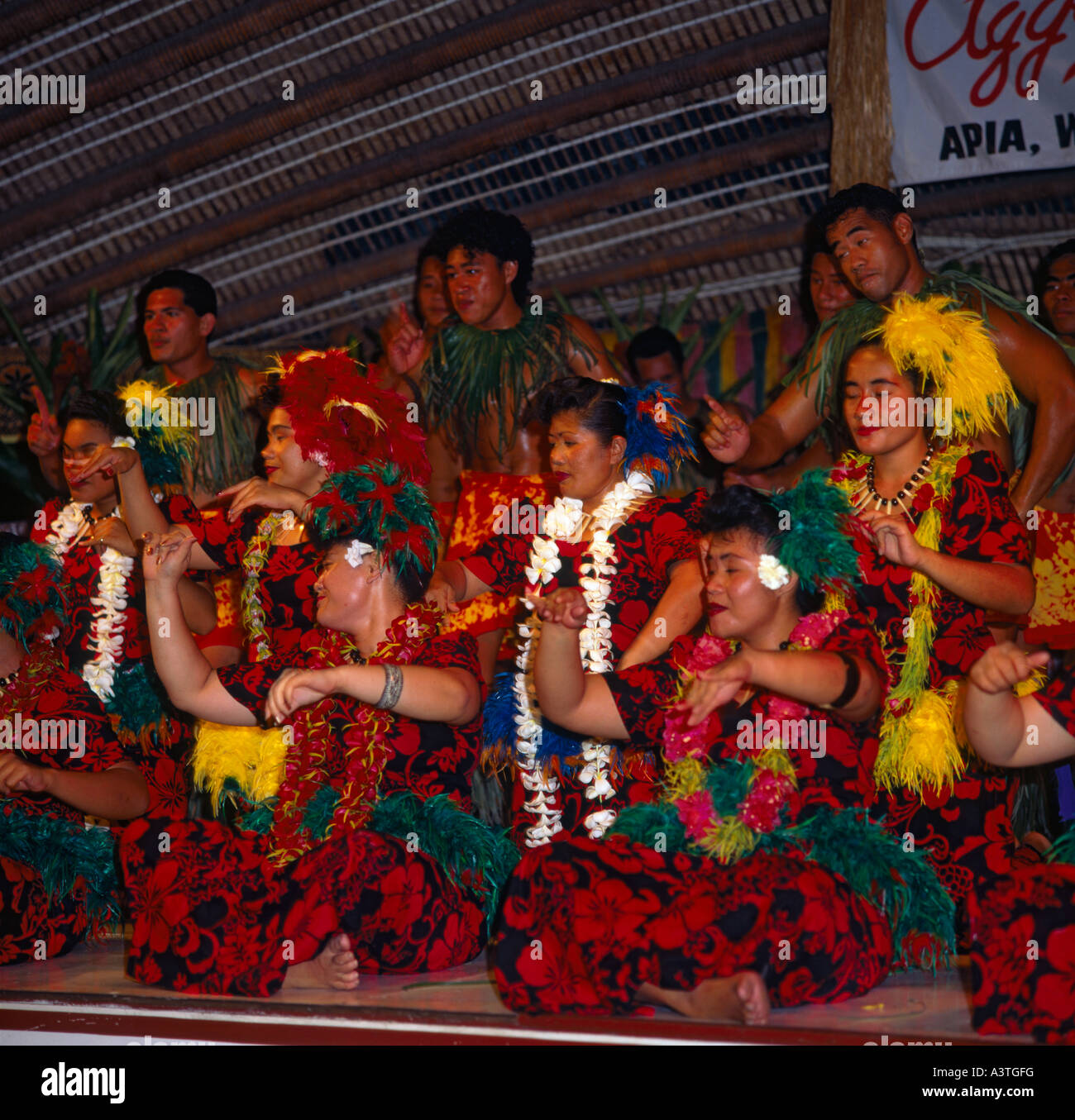 Group of local Samoan dancers in colourful dress wearing leis at Aggie Grey's Hotel in Apia town on Upolu Island Stock Photo