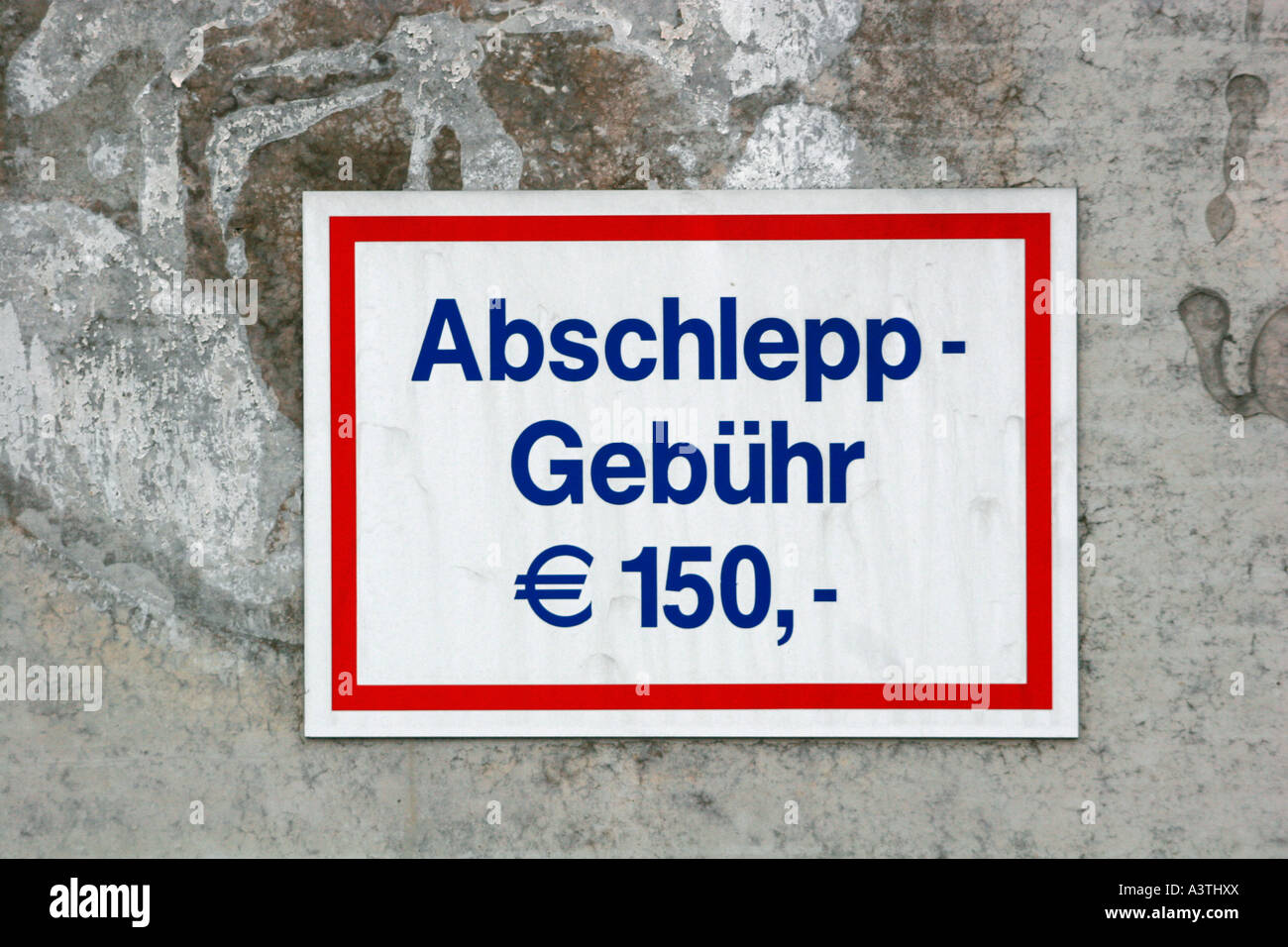 Sign on a wall 'towage charge 150Ae' - Stock Image
