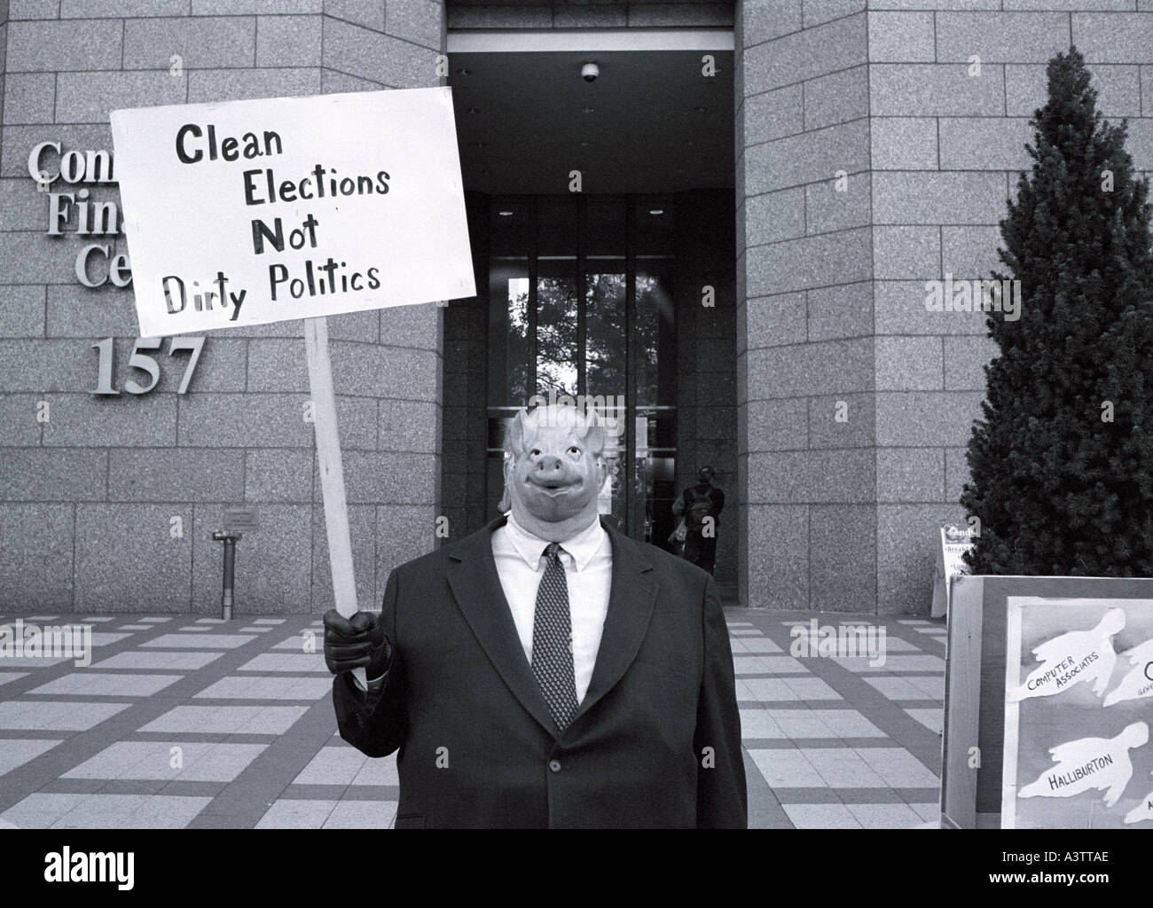 Protester with pig mask on protesting dirty politics and corporate greed - Stock Image