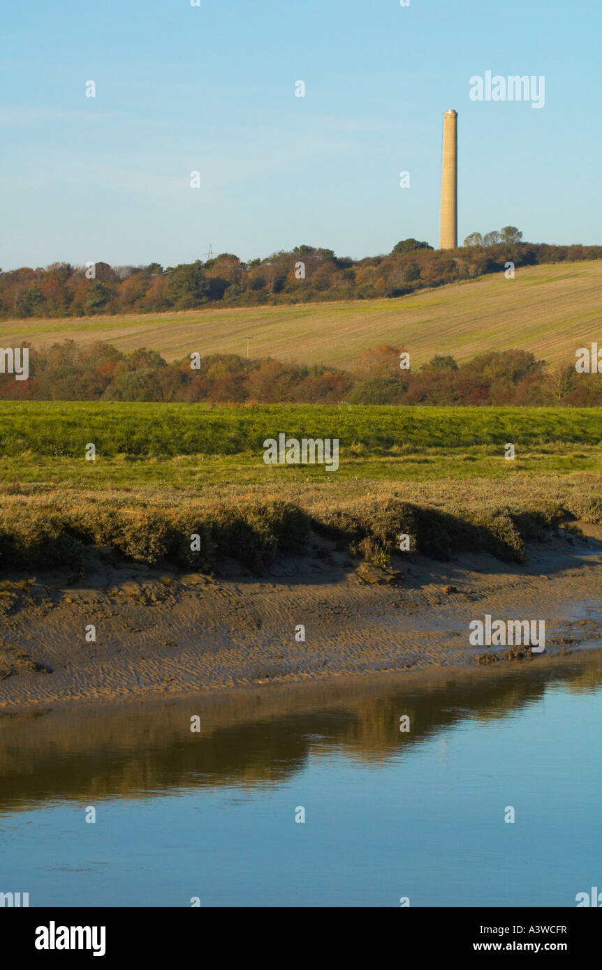The river Adur winds its way to Shoreham. The chimney from the now derelict cement works is visible in the background. Stock Photo