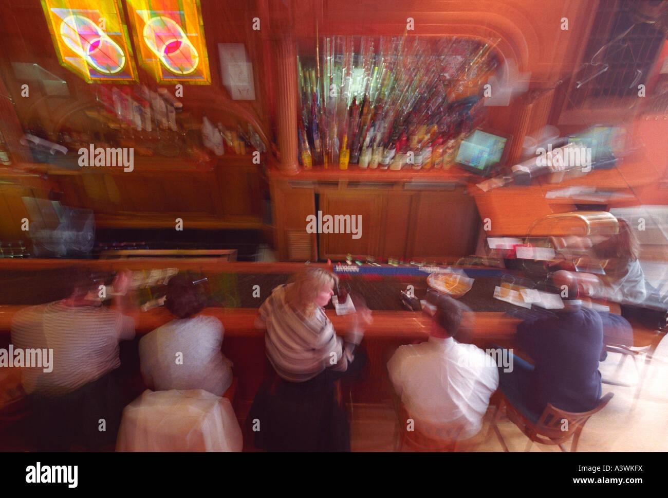 Bar scene in Michigan with blurry camera technique - Stock Image