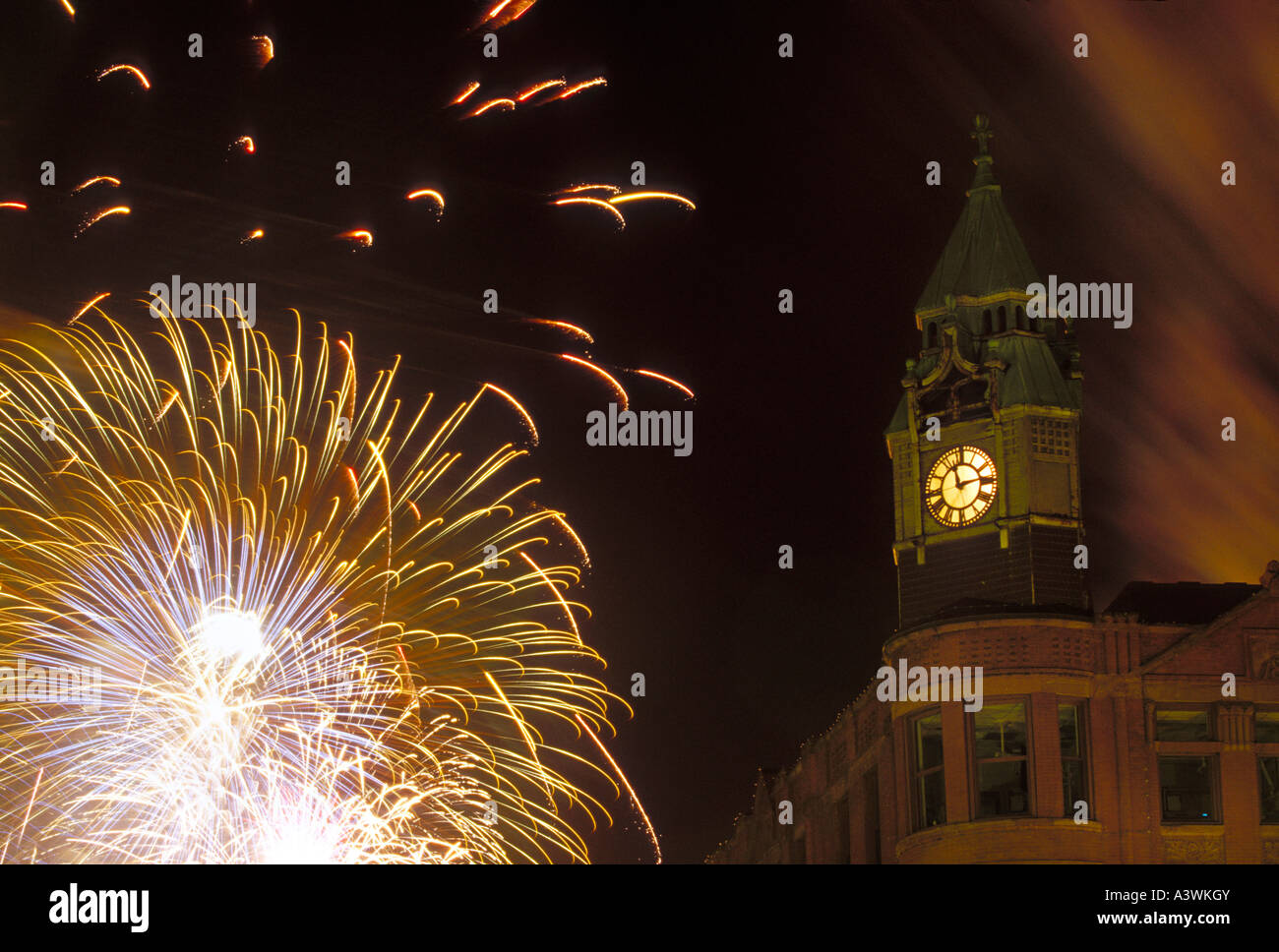 Fireworks burst around the historic Savings Bank building in downtown Marquette on the Fourth of July - Stock Image
