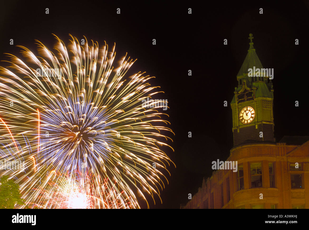Fourth of July fireworks burst behind the historic Savings Bank buiding in downtown Marquette Mich - Stock Image