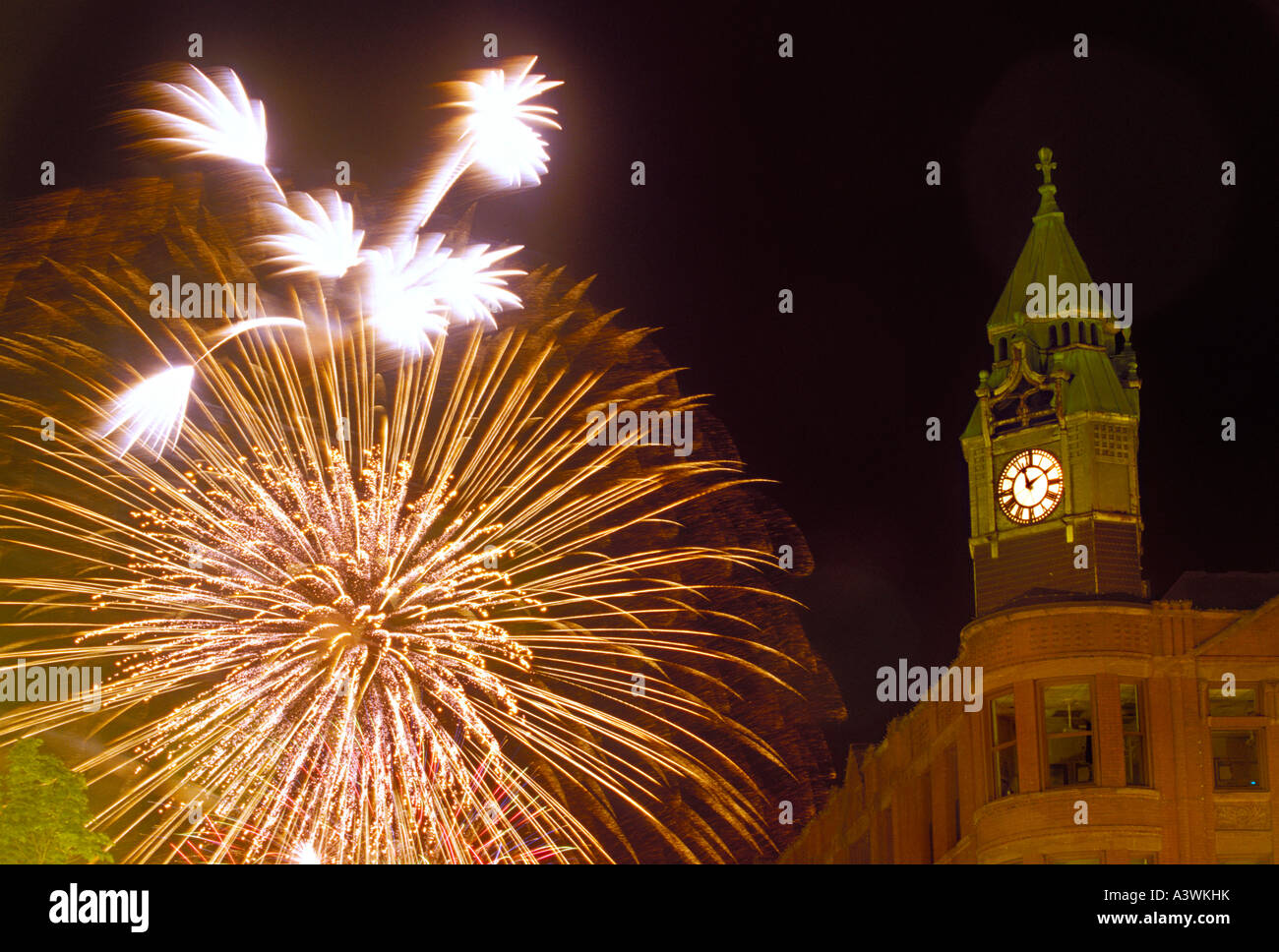 Fourth of July fireworks burst behind the historic Savings Bank building in Marquette Mich - Stock Image