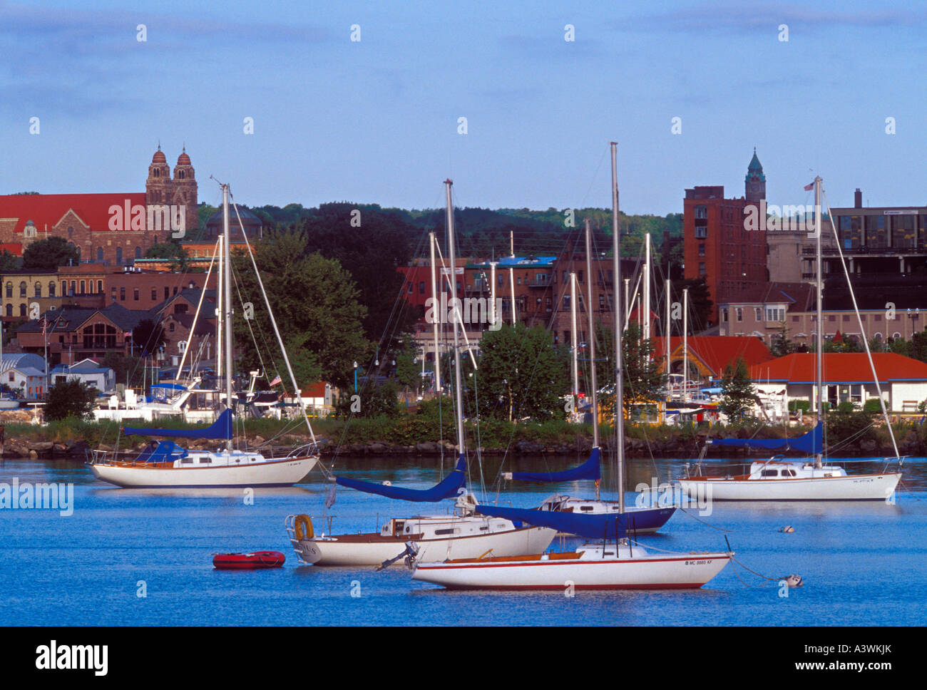 Sailboats anchor in the lower harbor of Marquette Mich - Stock Image