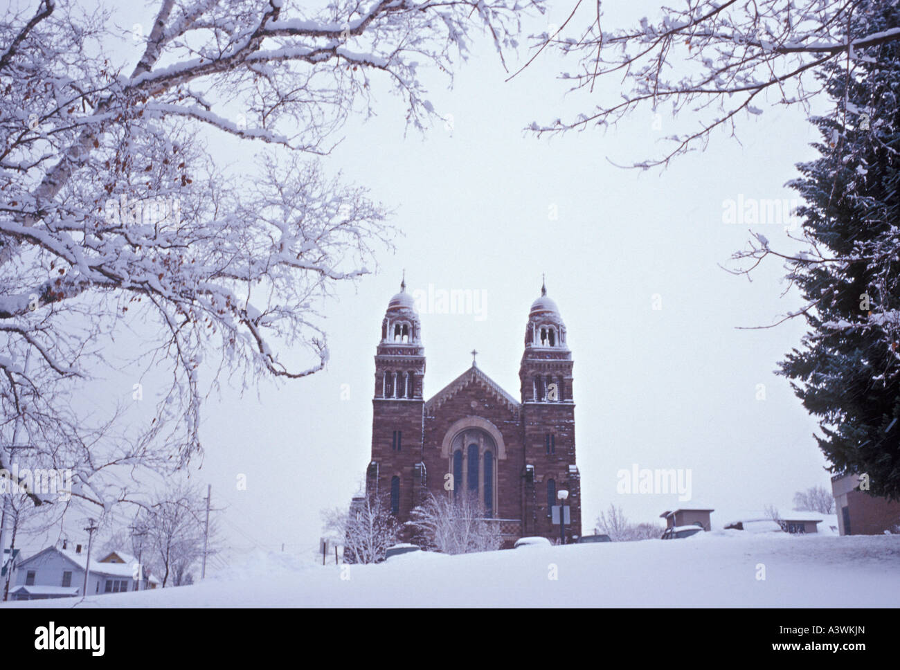 A snowstorm blankets St Peter Cathedral in Marquette Mich - Stock Image