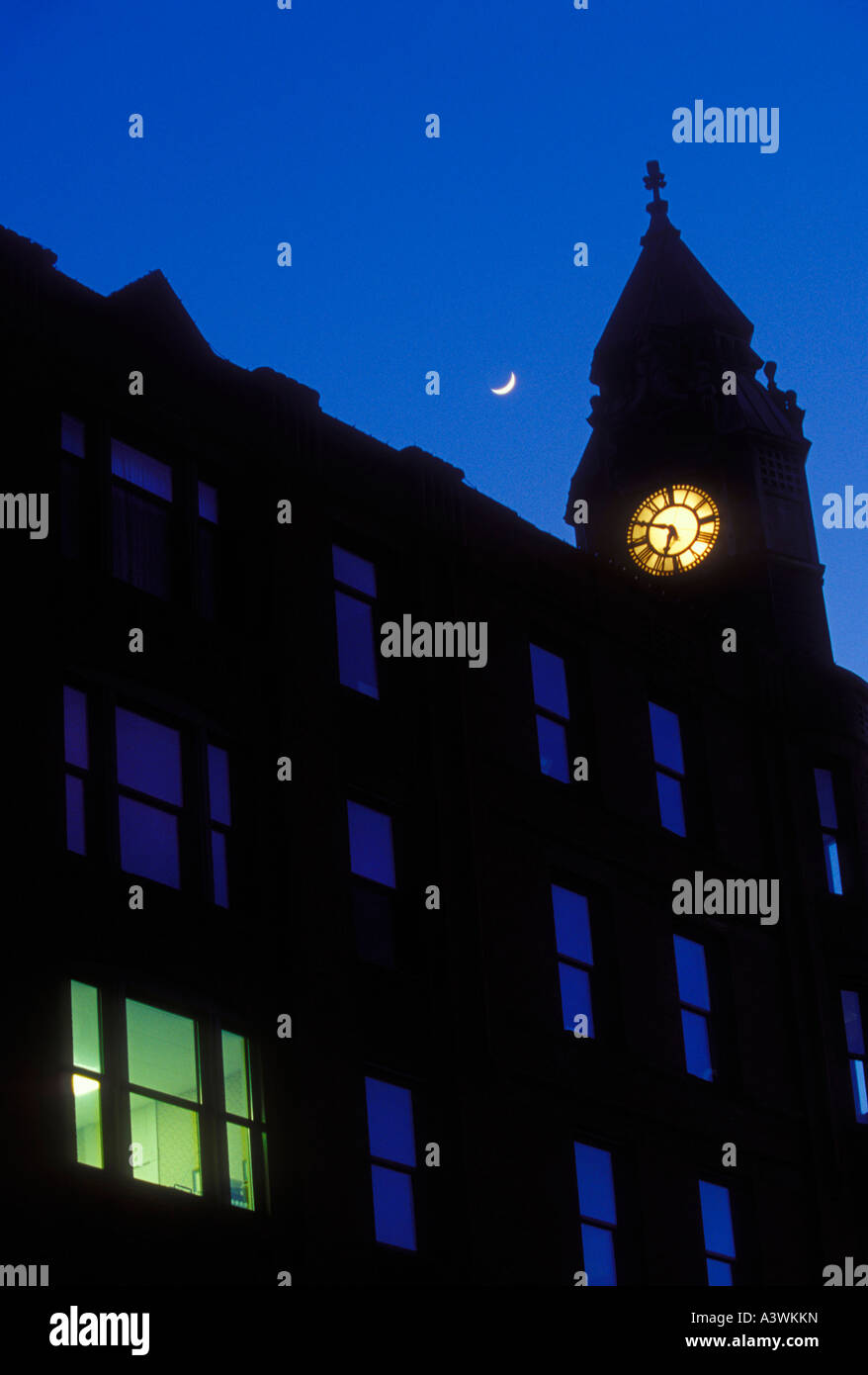 A crescent moon and the historic Savings Bank building in downtown Marquette Mich at dusk - Stock Image