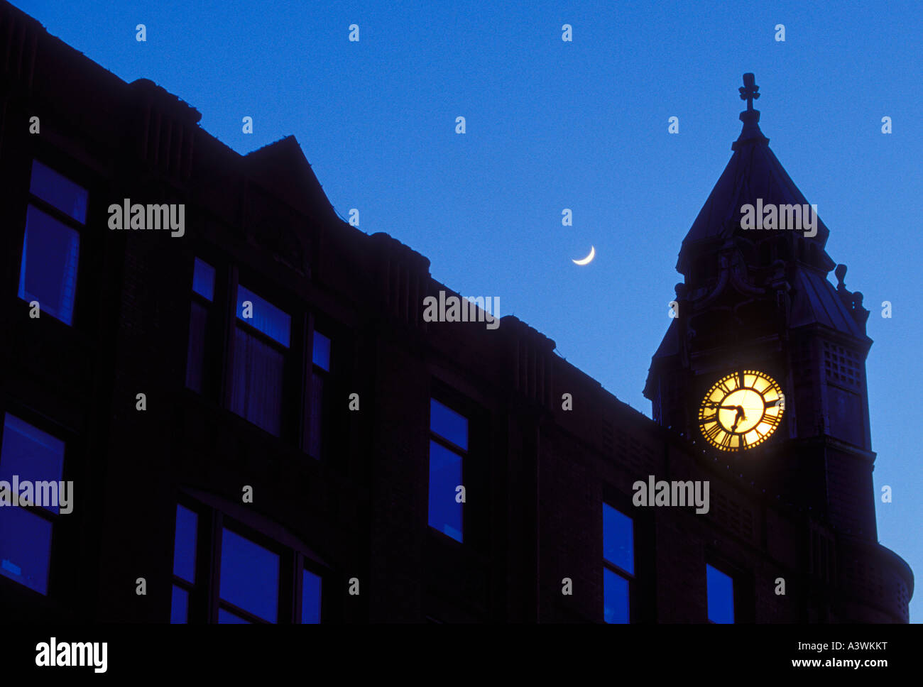 The historic Savings Bank building in downtown Marquette Mich with a crescent moon at dusk - Stock Image