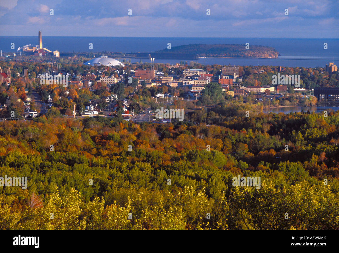 The city of Marquette Mich is seen from a lookout on Mount Marquette in fall - Stock Image