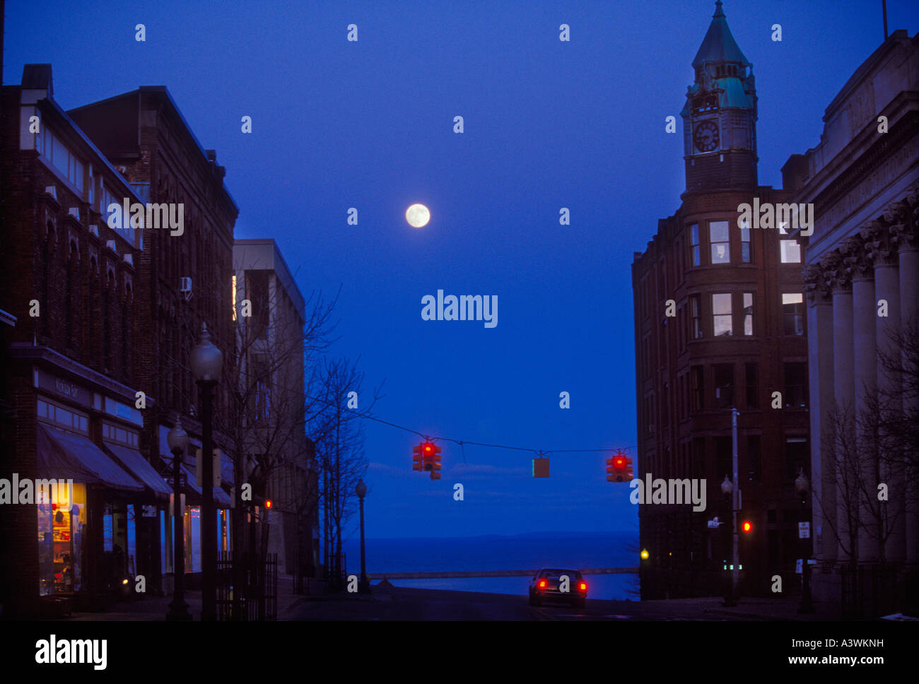 Downtown Marquette with a full moon at dusk - Stock Image