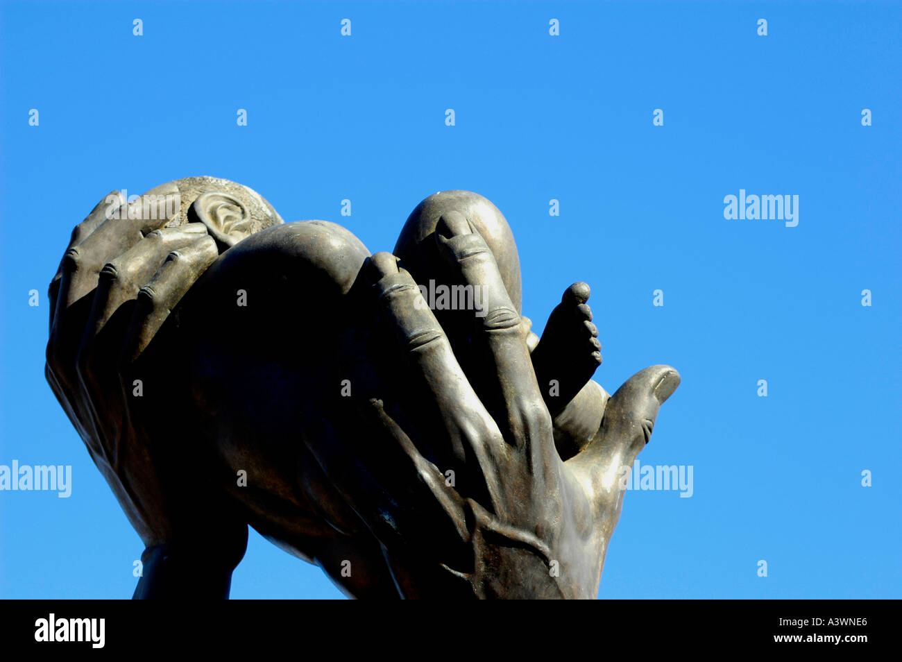 The BEHOLD statue at the MLK Center for Non Violance in Atlanta on Auburn Avenue Hands feet Baby Love Birth - Stock Image