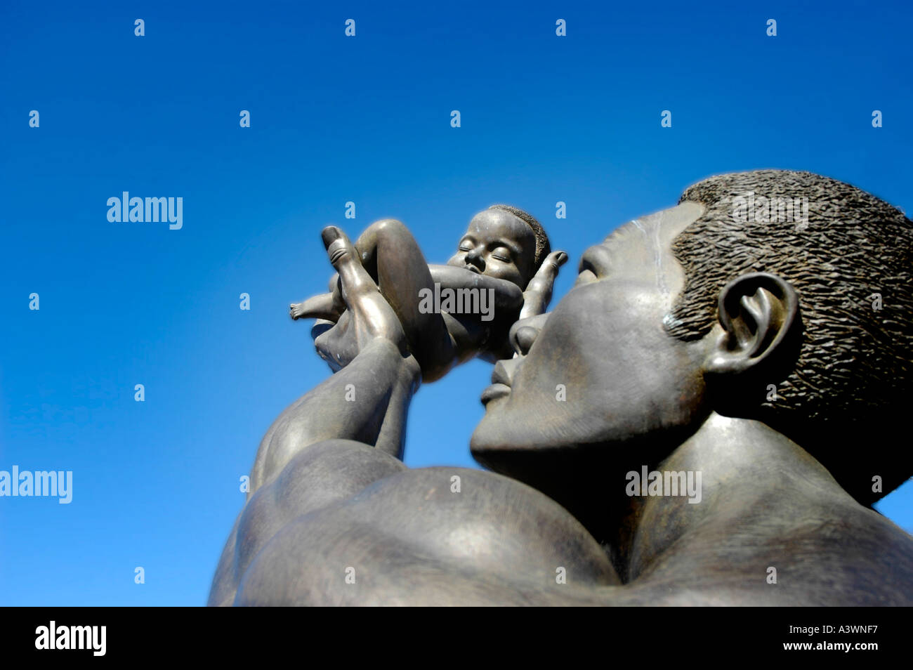 The BEHOLD statue at the MLK Center for Non Violance in Atlanta on Auburn Avenue Hands baby feet fingers birth love deliver - Stock Image