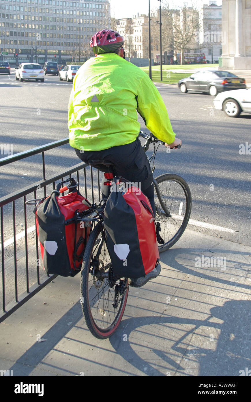 Cyclist wearing the gear in designated cycle lane at traffic lights waiting to cross Hyde Park Corner - Stock Image