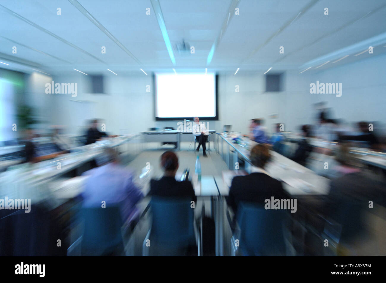 Lecture with audience in a big company. - Stock Image