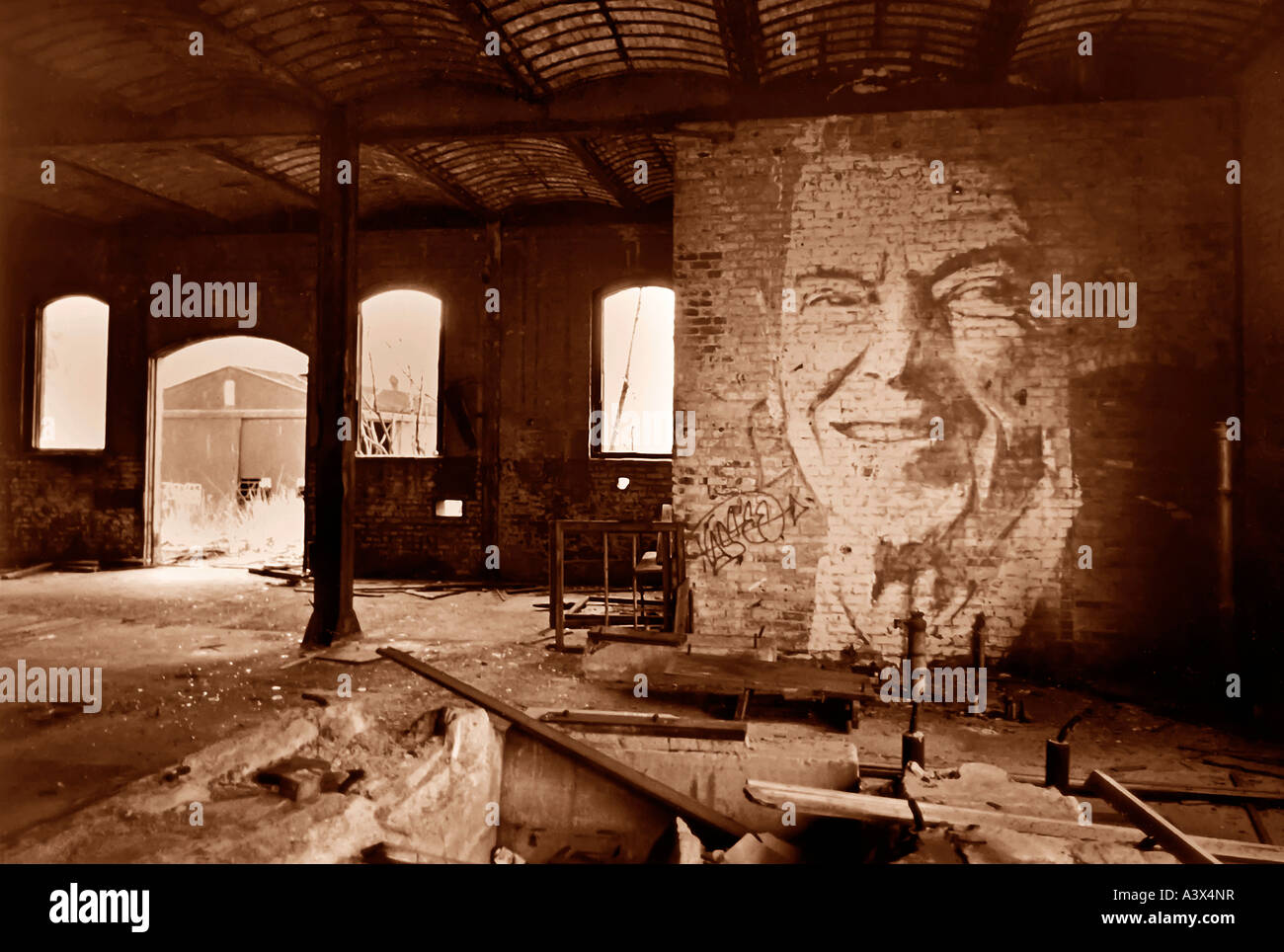 Portrait of former U S President Ronald Reagan painted on a wall inside an abandoned railroad hangar northest Pennsylvania - Stock Image