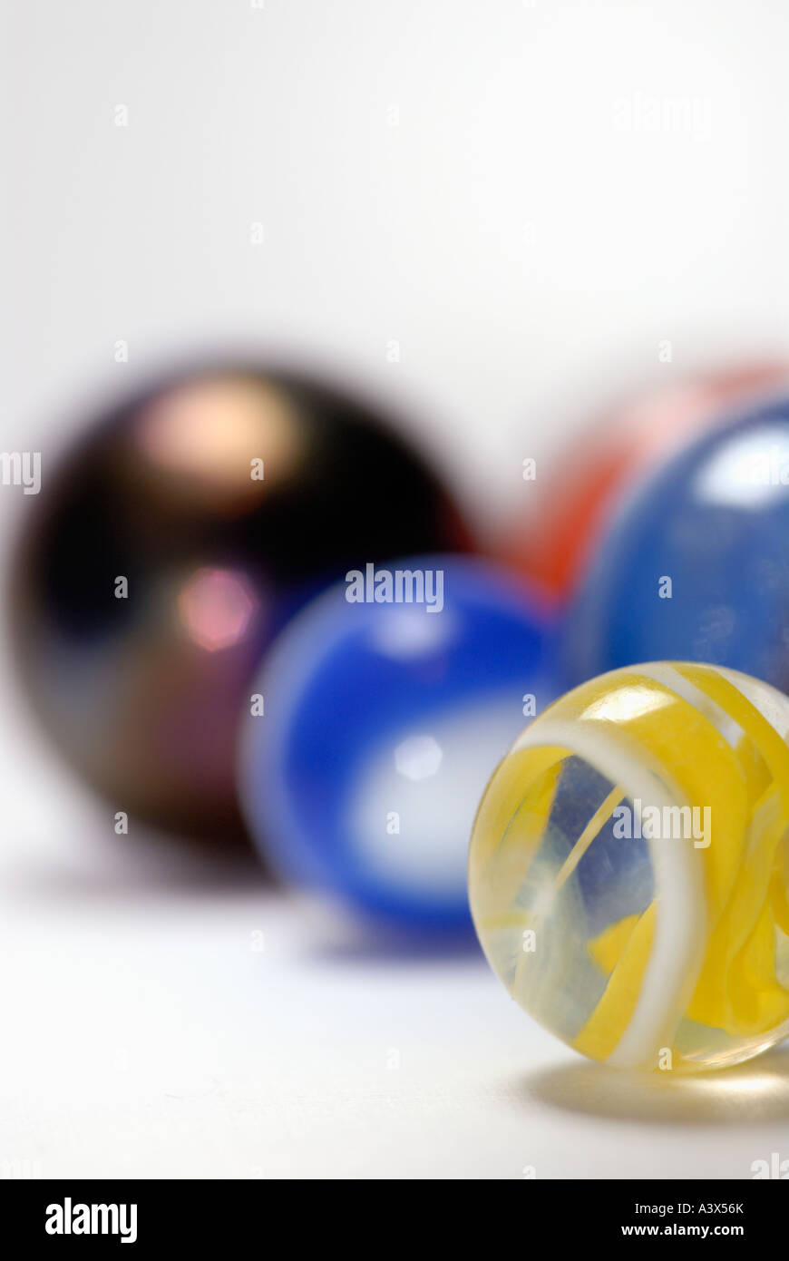 Closeup of marbles on a white surface Stock Photo